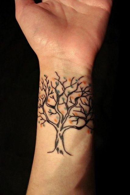 Tree with colorful leaves tattoo on the wrist