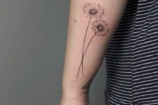 Two daisies tattoo on the forearm