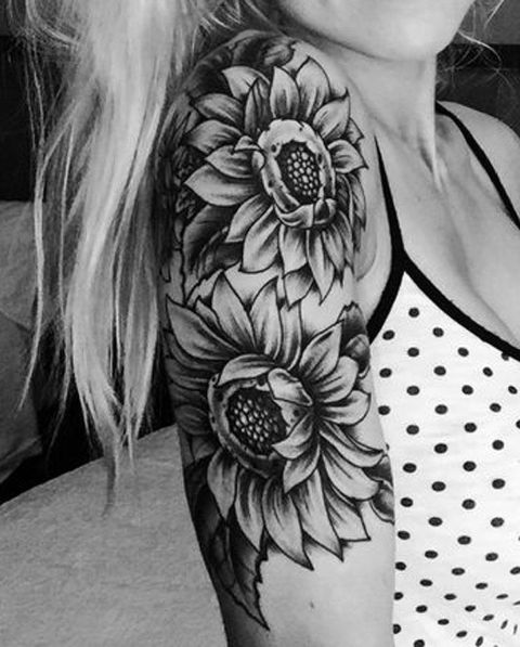 Two sunflower tattoos on the shoulder