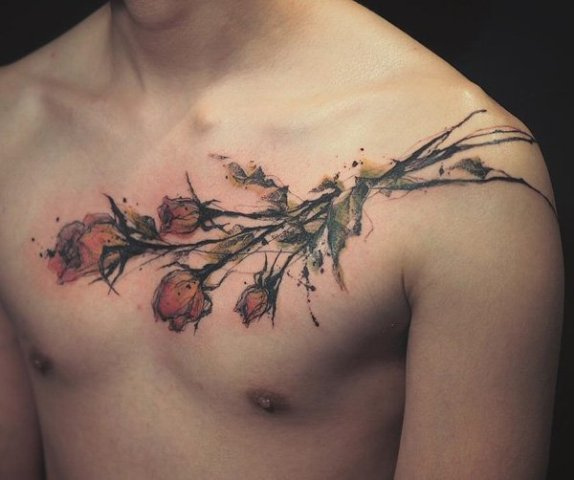 Watercolor rose tattoo on the chest and shoulder