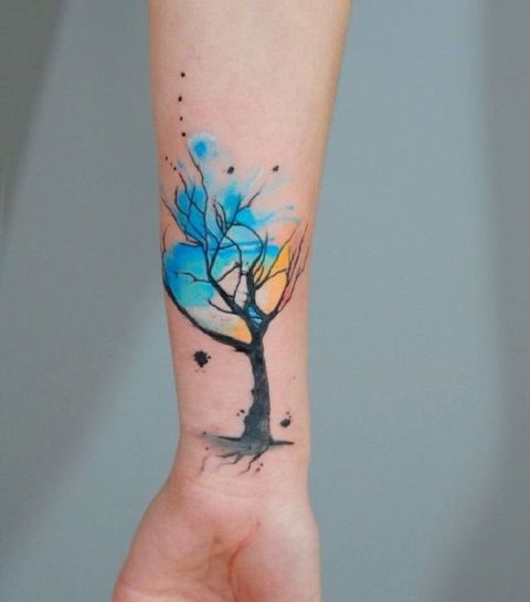 Watercolor tree tattoo on the forearm