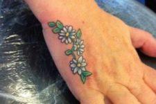White and green daisy tattoo idea