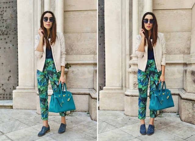 With beige jacket, black shirt, blue flat shoes and bag