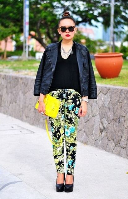 With black top, leather jacket, yellow clutch and black shoes