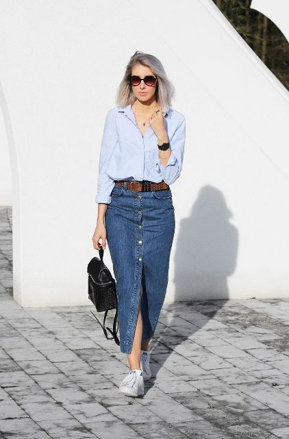 With button down shirt, white sneakers and black small bag