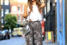 With crop top, silver bag and flat sandals
