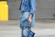 With cuffed jeans, denim long shirt, unique bag and white sneakers