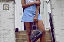 With lace top, black shoes and chain strap bag
