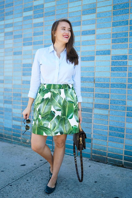 With light blue button down shirt, black bag and black flats
