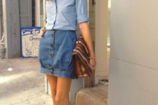 With light blue shirt, brown bag and two colored heels