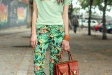 With light green t-shirt, brown flat shoes and brown leather bag