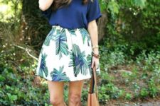 With navy blue loose shirt, brown sandals and tote