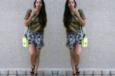 With olive green shirt, neon bag and black sandals