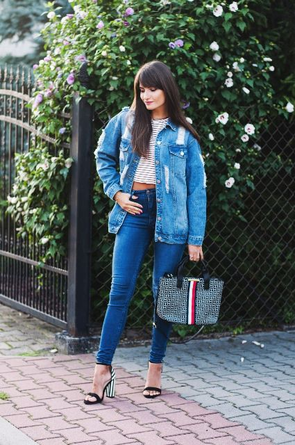 With striped crop top, skinny jeans, striped heels and printed bag