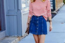 With striped loose shirt, red flats and leopard clutch
