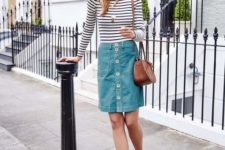 With striped shirt, leopard lace up flats and brown bag