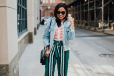 With t-shirt, striped pants, flat sandals and green bag