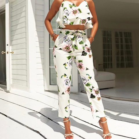 With tropical printed ruffled crop top and high heels