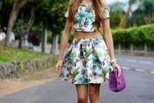 With tropical top, purple bag and yellow pumps