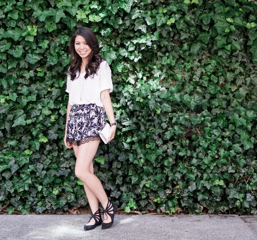With white blouse, black lace up shoes and mini clutch