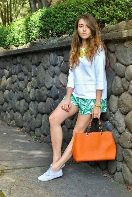 With white blouse, orange bag and white sneakers