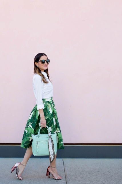 With white button down shirt, mint bag and metallic shoes