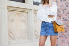 With white lace blouse, yellow and printed bag and gladiator sandals