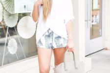 With white loose blouse, gray bag and tassel sandals
