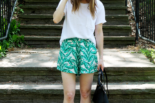 With white loose t-shirt, black and white flat shoes and black bag