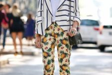 With white shirt, striped jacket, black bag and marsala pumps