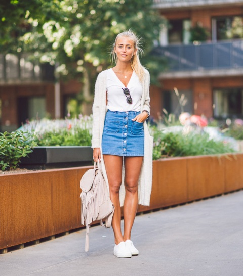 With white shirt, white sneakers and fringe backpack