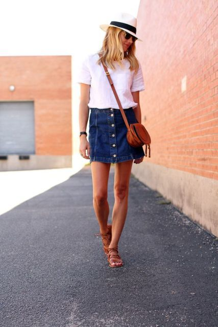 With white shirt, wide brim hat, crossbody bag and brown sandals