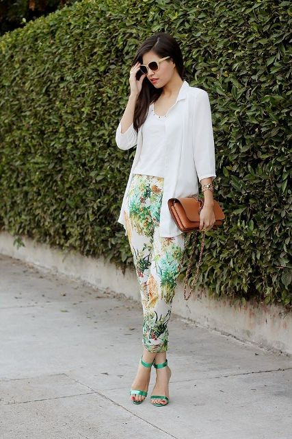 With white top, white shirt, green sandals and brown leather clutch