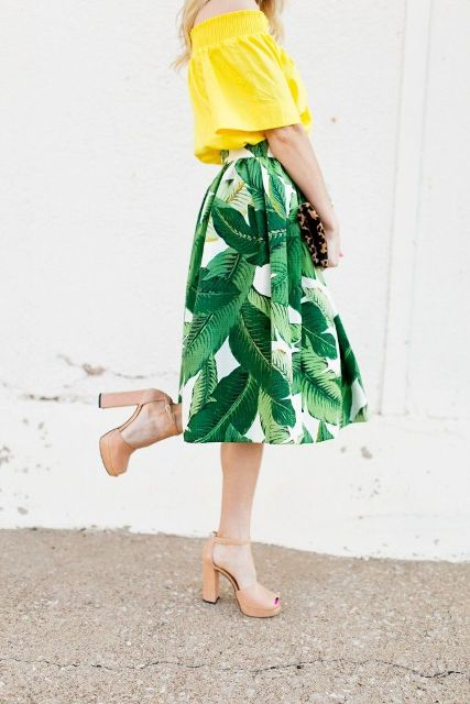 With yellow off the shoulder blouse, printed clutch and beige heels