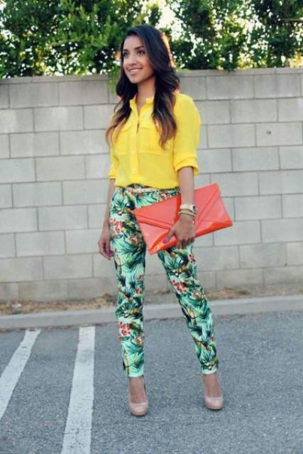 With yellow shirt, big clutch and beige pumps