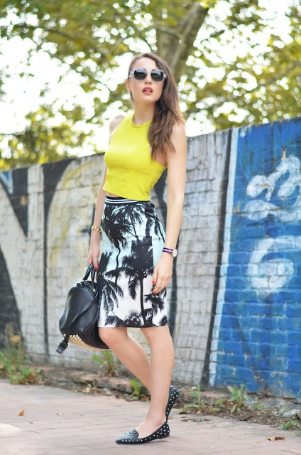 With yellow top, embellished flats and black bag