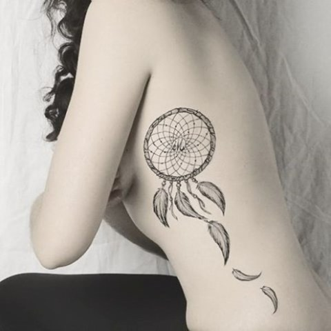 Wonderful tattoo on the side