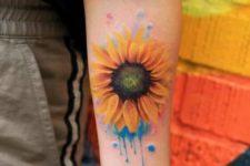 Yellow and orange sunflower tattoo