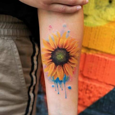Yellow and orange sunflower tattoo