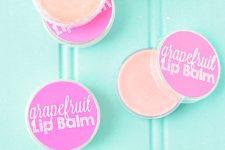 DIY grapefruit lip balm recipe with a slight pink shade