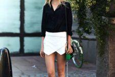 02 a black shirt, a white asymmetrical mini skirt, black sandals and a colorful  bag