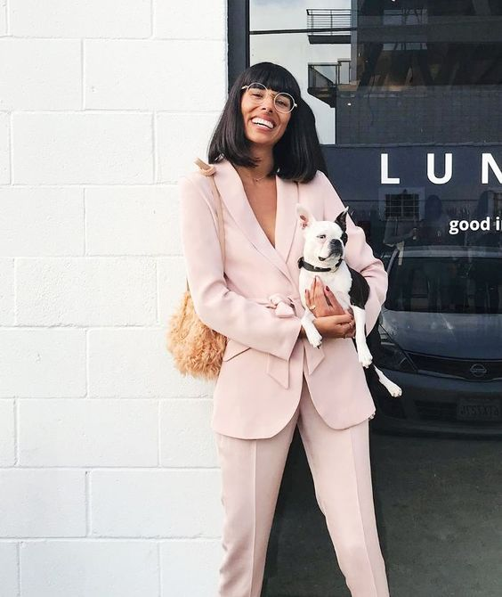 a blush pantsuit, a straw bag and glasses to rock to an office in summer