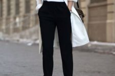02 a minimalist outfit with black pants and shoes and a white tee and duster