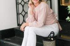 white raw hem jeans, a blush and white striped shirt, white mules and a trendy bucket bag