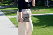 03 a black long sleeve top, creamy culottes, cream and black shoes and a large bag