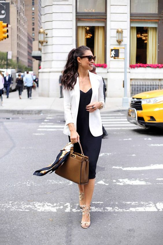 a black midi dress, a white jacket, creamy strappy heels and a brown bag for a stylish work look
