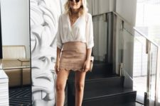 03 a blush perforated mini, a white blouse, layered necklaces and grey strappy shoes