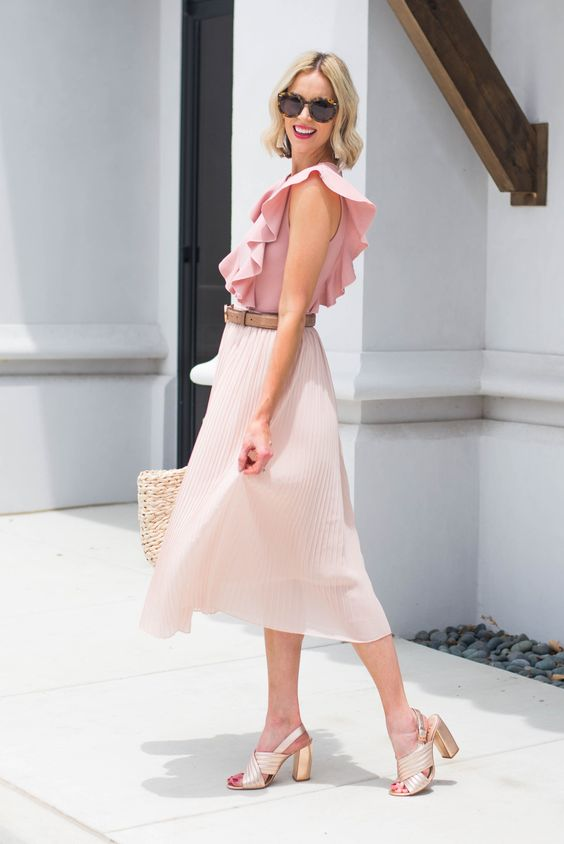 a blush pleated midi skirt, a pink ruffled top, metallic shoes and a straw bag for a summer work look