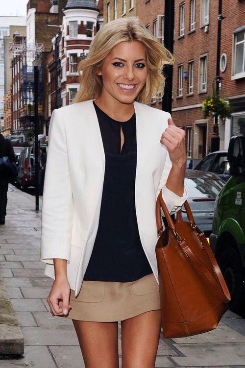 a navy top, a tan mini, a white blazer and a large brown leather bag for a cool look