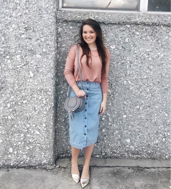 a pink shirt, a blue button down pencil denim skirt and silver mules